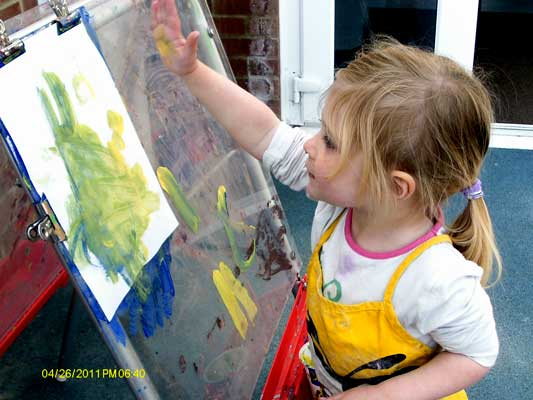 A child painting with her hand